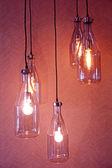 Hanging light bulbs, on red background. — Zdjęcie stockowe