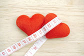 Red heart with meter curling around — Stock Photo