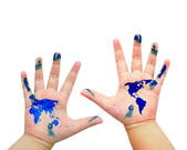 World map painted on children hands isolated on white background — Stock Photo