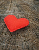 Red heart on wood background — Stok fotoğraf