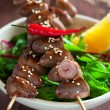 Grilled chicken hearts in spicy soy citrus marinade on skewers - Stock Photo