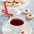 Royalty-Free Stock Photo: Cup of hot tea and homemade almond cookies filled with jam