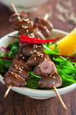 Grilled chicken hearts in spicy soy citrus marinade on skewers — Stock Photo