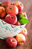 Fresh ripe apples in ceramic colander — Stock Photo