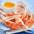 Boiled crab claws with orange sauce — Stock Photo