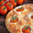 Focaccia with cherry tomatoes — Stock Photo