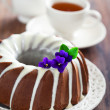Chocolate bundt cake with icing — Stock Photo