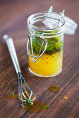 Salad dressing with olive oil — Stock Photo