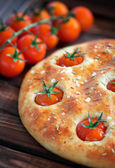 Focaccia with cherry tomatoes — Stock Photo