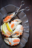 Boiled crab claws on plate — Stock Photo
