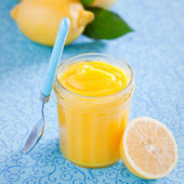 Homemade lemon curd in glass jar — Stock Photo