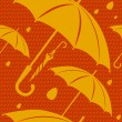 Vector seamless pattern with yellow umbrellas. — Stockvektor