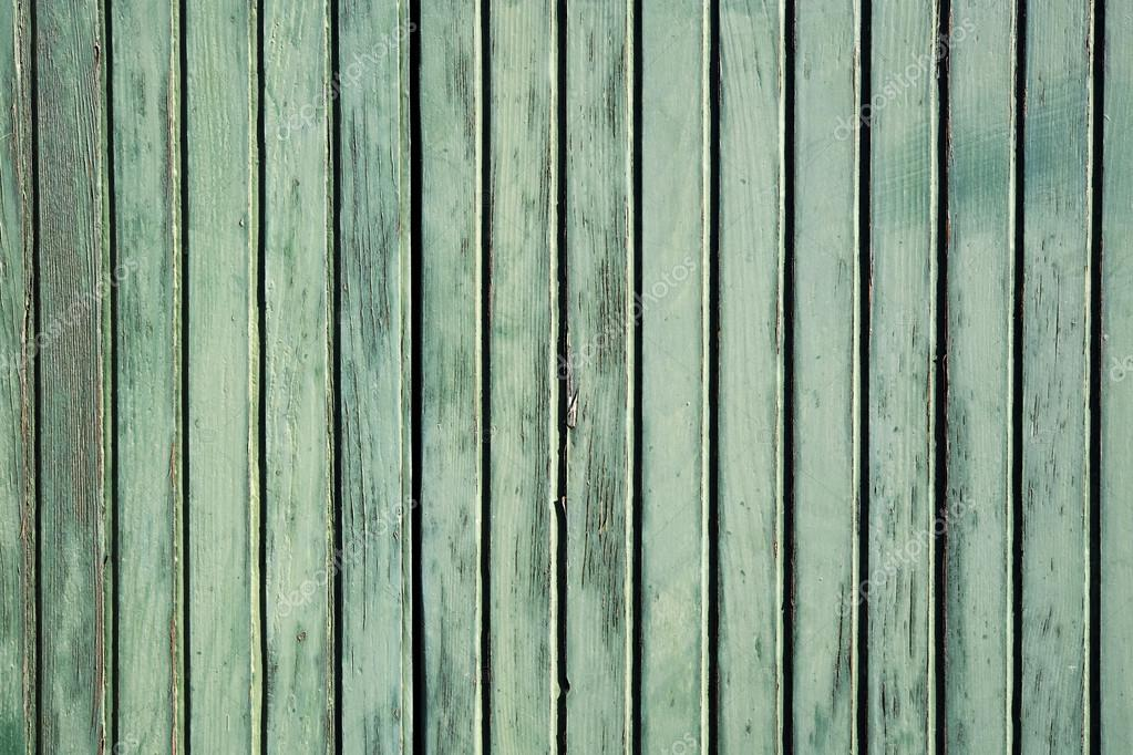 Grunge wooden background of an old exterior weathered timber wall with parallel planks Grunge wooden background of an old timber wall with parallel planks — Stock Photo #13248260