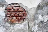 Damaged brick wall — Stock Photo