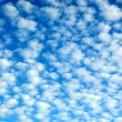 Pretty blue cloudscape with fluffy clouds - Stock Photo