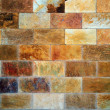 Variegated cut stone wall — Stock Photo