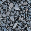 Wet waterworn pebbles - Stock Photo