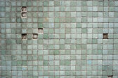 Grungy mosaics with missing tiles — Stock Photo