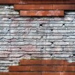 Damaged wall with missing bricks — Stock Photo