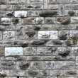 Irregular rectangular stone brick wall — Stock Photo
