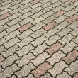 Interlocking wavy floor bricks — Foto Stock