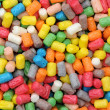 Colourful plastic pellets — Stock Photo