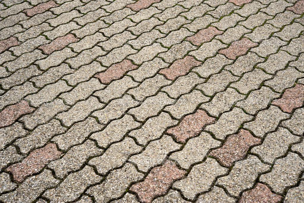 Interlocking wavy floor bricks — Stock Photo ...
