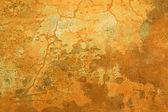 Grungy ochre wall with cracks — Stock Photo