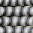 Grey electrical conduit or tubing — Stock Photo #18418873
