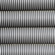 Grey electrical conduit or tubing — Stock Photo