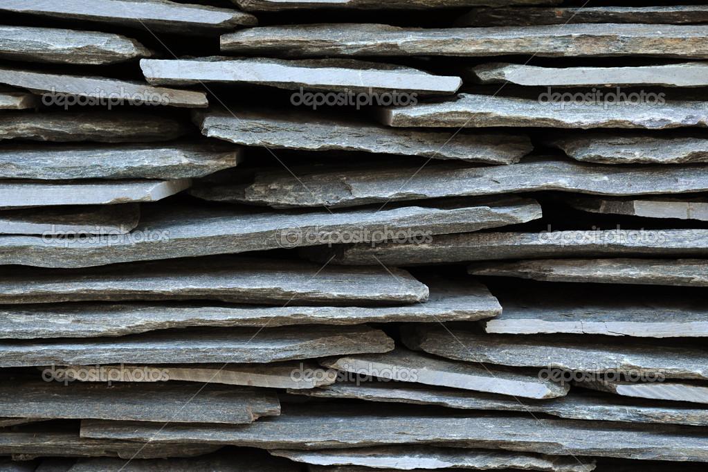 wand hergestellt aus ineinander verwobene steine wand aus. Black Bedroom Furniture Sets. Home Design Ideas