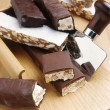 Stock Photo: Nutty nougat in dark chocolate