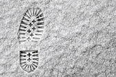 Single footprint in snow — Stok fotoğraf