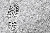 Single footprint in snow — Stock Photo