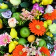 Stock Photo: Colourful flower and fruit arrangement