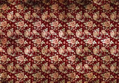 Retro burgundy wallpaper with flowers — Stock Photo