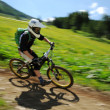 Downhill bike racer — Stock Photo