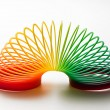 Rainbow coloured slinky toy — Stock Photo