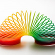 Stock Photo: Rainbow coloured slinky toy
