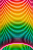 Rainbow colours of a plastic slinky toy — Stock Photo