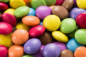 Background of colourful smarties — Stock Photo