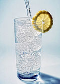 Cold fresh mineral water poured into a glass — Stock Photo