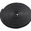 Coiled black rope — Stock Photo