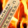 Stock Photo: Mercury thermometer indicating high temperature