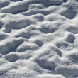 Undulating surface of fresh snow in winter — Stock Photo #38779495