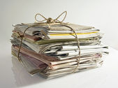 Stack of old newspapers tied with string — Stock Photo