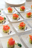 Display of smoked salmon appetizers — Stock Photo