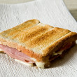 Crisp toasted ham and cheese sandwich — Stock Photo