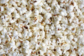 Background texture of freshly made popcorn — Stock Photo