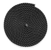 Neatly coiled braided plaited black rope — Stock Photo